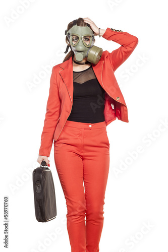 young business woman walking with a gas mask