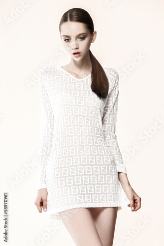 Fashion model pose on gray background