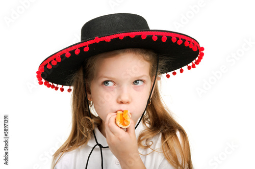 Image of a little girl eating pizza wearing a hat