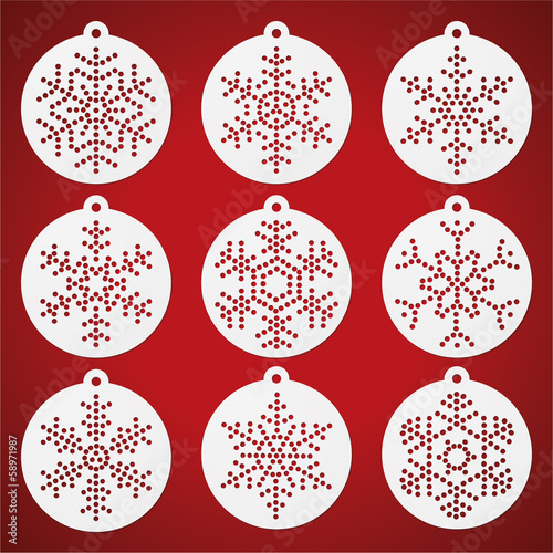 Paper christmas balls with punched snow flakes