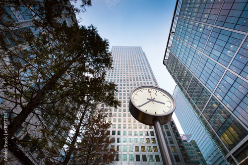 Clock in front of business building in Canary Wharf