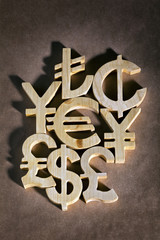 international currency units by wood on recycled background