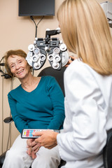 Smiling Senior Woman Undergoing Eye Checkup