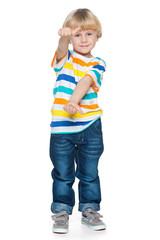 Joyful little boy holding his thumbs up