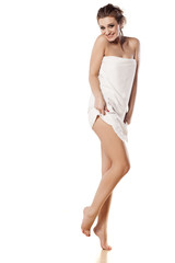pretty girl posing in towel on white background