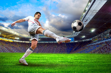 Fototapeta piłkarz kopię piłkę na stadionie
