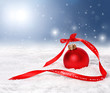 Christmas background with red bauble and merry christmas ribbon