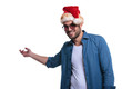 young casual man in santa hat is presenting something