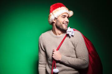 laughing santa man looking to his back