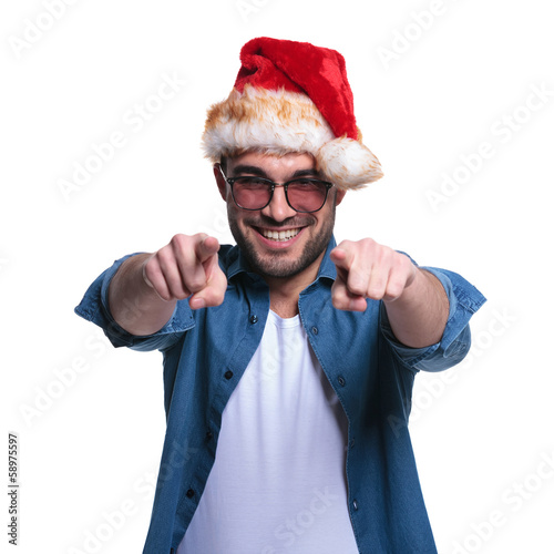 man in santa hat is pointing his fingers