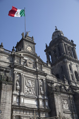 Panoramic view of the cathedral of Mexico and mexican flag