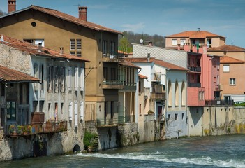 Houses standing on embankment of Salat river