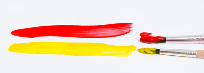 Paint brushes and paint isolated on a white