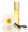 Women's perfume in beautiful bottle with flower and vanilla