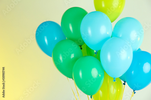 Colorful balloons on color background