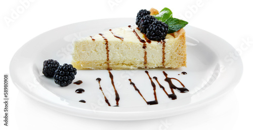 Slice of cheesecake with chocolate sauce and blackberry