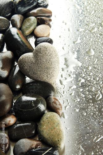 Fototapeta Grey stone in shape of heart, on light background