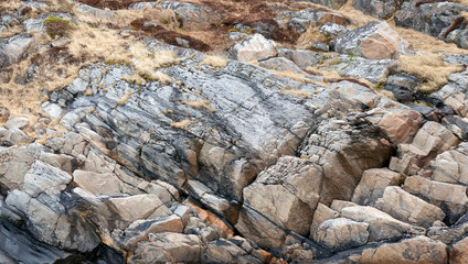 Natural photo background texture of stone coast in Norway