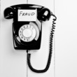 retro black phone with fraud message, fraud reporting - 58982963
