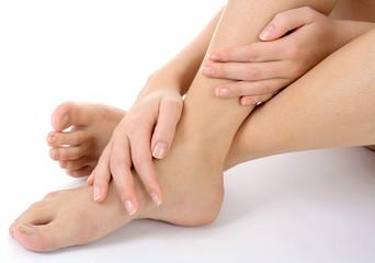 Frau bei Fuß-Massage