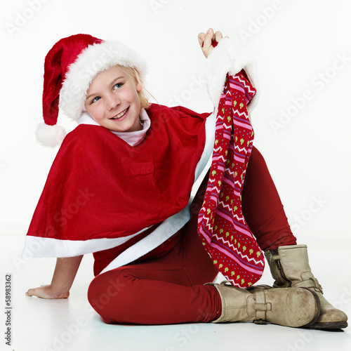 Cute girl with Santa Claus