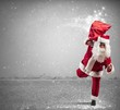 Running Santa Claus with magic gifts