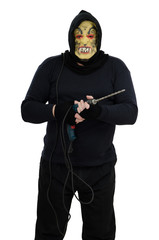 Maniac in a mask holds a electric drill