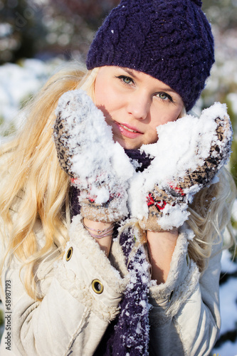 beautiful winter woman playing with snow