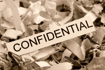 Papierschnitzel Confidential