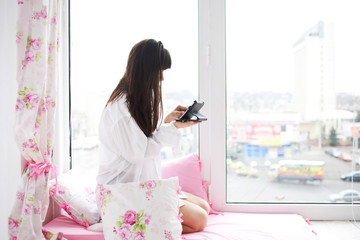 Young woman checking email and social networking accounts