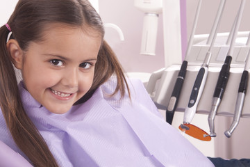 beautiful little girl in dental office smiling