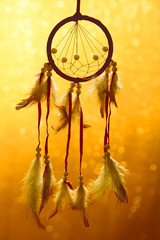 Beautiful dream catcher on yellow background with lights