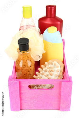 Wooden box with cosmetic products isolated on white