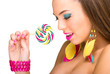 Colorful fashion model with lollipop