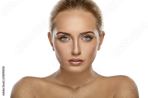 Beautiful portrait of a girl. Nude makeup. White background.