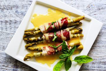 Grilled young asparagus wrapped in prosciutto