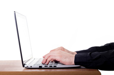 Man's fingers on the keyboard of laptop