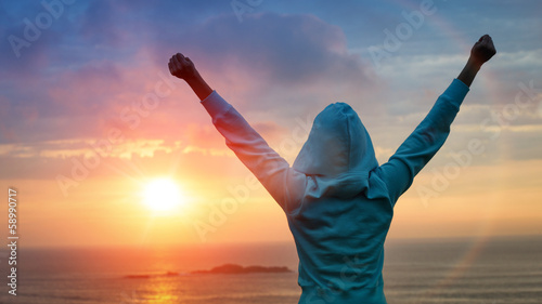 Sport success on sunset background