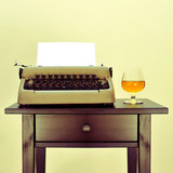 old typewriter and liquor