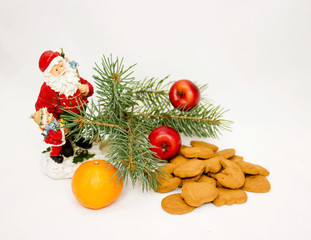 Christmas composition of cookies, Santa, fir, tangerine on white