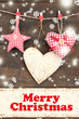 Decorative hearts and star on rope, on wooden background