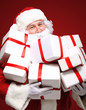 Photo of Santa Claus with giftboxes looking at camera