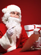 Portrait of Santa Claus looking at envelope in his hands