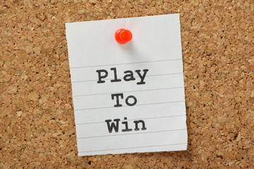 Play To Win on a cork notice board