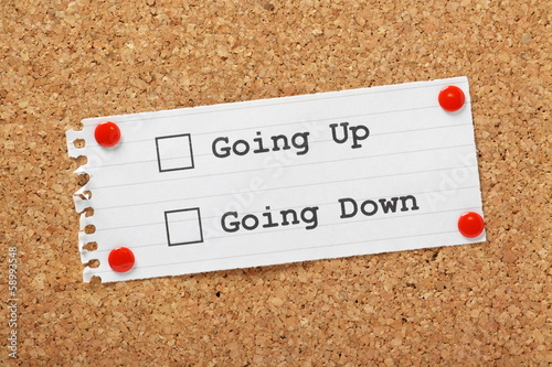 Going Up or Down Tick Boxes on a cork notice board