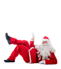 Santa Claus lying on white background