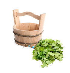 Wooden bucket and oak broom for Russian bath.