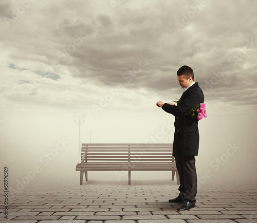young serious man waiting woman