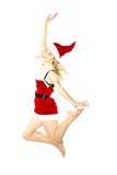 Happy smiling woman in red xmas costume jumping high