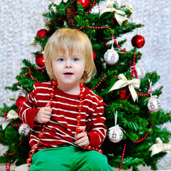Little boy preparing for Christmas holidays